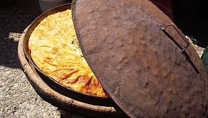 Spiral/layered banitsa with cheese baked under vrashnik